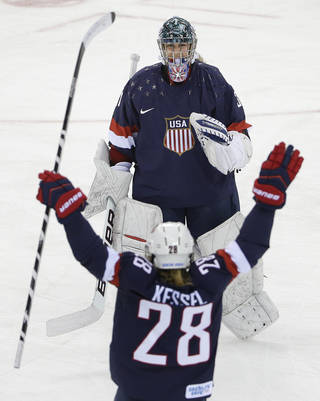 USA Goalkeeper Jessie Vetter is greeted by Amanda Kessel after the USA beat Sweden 6-1 during the 2014 Winter Olympics women's semifinal ice hockey game at Shayba Arena, Monday, Feb. 17, 2014, in Sochi, Russia. (AP Photo/Matt Slocum) Matt Slocum -