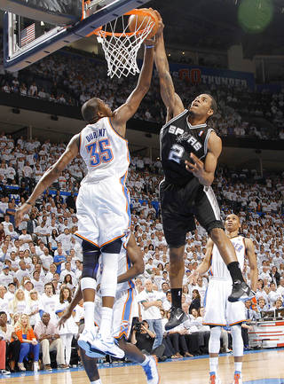 The Thunder's Kevin Durant defends San Antonio's Kawhi Leonard during Game 6. Photo by Chris Landsberger, The Oklahoman