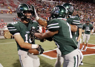 Norman North's Tyler Sipe (18) is congratulated after a touchdown pass reception as the Norman High School Tiger football team plays the Norman North Timberwolves at Gaylord Family/Oklahoma Memorial Stadium on Thursday, Aug. 30, 2012 in Norman, Okla. Photo by Steve Sisney, The Oklahoman