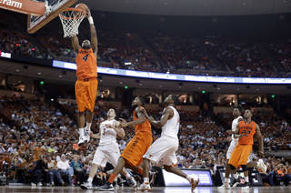 Oklahoma State's Brian Williams (4) scores against Texas during the second half of an NCAA college basketball game, Saturday, Feb. 9, 2013, in Austin, Texas. Oklahoma State won 72-59. (AP Photo/Eric Gay) ORG XMIT: TXEG110