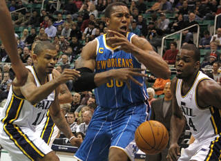New Orleans Hornets forward David West (30), center, loses the ball as he is defended by Utah Jazz guard Earl Watson (11), left, and forward Paul Millsap (24), right, during the first half of an NBA basketball game on Thursday, March 24, 2011, in Salt Lake City. (AP Photo/Jim Urquhart) ORG XMIT: UTJU103