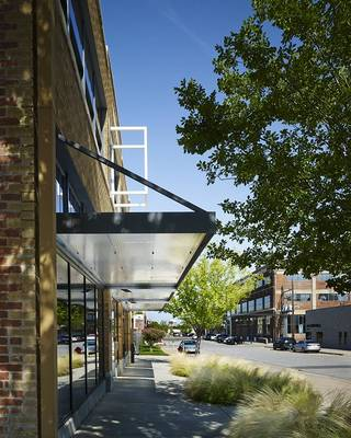 A sidewalk view of Lingo Construction Services, 123 NW 8. - PROVIDED BY ELLIOTT + ASSOCIATES ARCHITECTS
