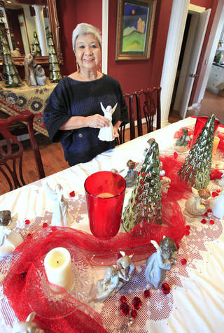 Marcy Tolentino, a Filipino immigrant living in Oklahoma City, decorates for Christmas as she discusses how her family blends American Thanksgiving traditions with Filipino elements at her home in Oklahoma City Friday, Nov. 22, 2103. Photo by Paul B. Southerland, The Oklahoman