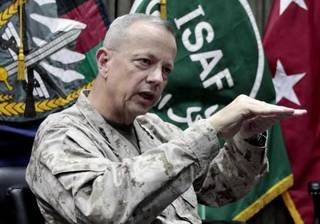 """FILE - This July 22, 2012, file photo shows U.S. Gen. John Allen, top commander of the NATO-led International Security Assistance Forces (ISAF) and U.S. forces in Afghanistan, during an interview with The Associated Press in Kabul, Afghanistan. The Pentagon says Gen. John Allen is under investigation for alleged """"inappropriate communications"""" with Jill Kelley, the woman who is said to have received threatening emails from Paula Broadwell, the woman with whom former CIA Director David Petraeus had an extramarital affair. Defense Secretary Leon Panetta says the FBI referred the matter to the Pentagon on Sunday, Nov. 11, 2012. Panetta says he ordered a Pentagon investigation of Allen on Monday. (AP Photo/Musadeq Sadeq, File) ORG XMIT: NY107"""