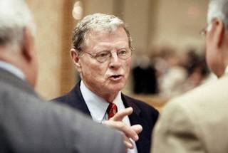 Sen. Jim Inhofe, R-Tulsa, talks with individuals after speaking at a Greater Oklahoma City Chamber of Commerce breakfast in Oklahoma City Thursday, August 26, 2010. Photo by Paul B. Southerland, The Oklahoman ORG XMIT: KOD