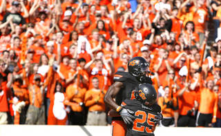 CELEBRATION: Oklahoma State's Justin Blackmon (81) and Josh Cooper (25) celebrate a touchdown during the first half of the college football game between the Oklahoma State University Cowboys (OSU) and the University of Kansas Jayhawks (KU) at Boone Pickens Stadium in Stillwater, Okla., Saturday, Oct. 8, 2011. Photo by Sarah Phipps, The Oklahoman ORG XMIT: KOD