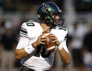 Norman North's David Cornwell looks to throw a pass during a high school football game between Yukon and Norman North in Yukon, Okla., Friday, Oct. 4, 2013. Photo by Sarah Phipps, The Oklahoman
