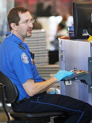 Transportation Security Administration agents screen bags at Will Rogers World Airport in Oklahoma City in this file photo. Photo by Nate Billings, The Oklahoman Archives