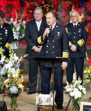 Oklahoma City Fire Chief Keith Bryant talks at the funeral of Nichols Hills Fire Chief Keith Bryan on Saturday at The Bridge Assembly of God in Mustang. PAUL HELLSTERN