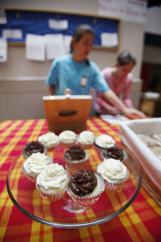 Westminster School students sell cupcakes Tuesday during their lunch hour in Oklahoma City.