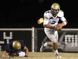 Former Heritage Hall quarterback Quinn Shanbour, shown here during a 2011 game, will walk on to the Oklahoma State football team. PHOTO BY SARAH PHIPPS, Oklahoman Arcives SARAH PHIPPS