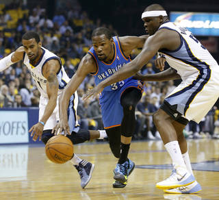 Oklahoma City's Kevin Durant (35) takes the ball between Memphis' Mike Conley (11), left, and Zach Randolph (50) during Game 3 in the first round of the NBA playoffs between the Oklahoma City Thunder and the Memphis Grizzlies at FedExForum in Memphis, Tenn., Thursday, April 24, 2014. Photo by Bryan Terry, The Oklahoman