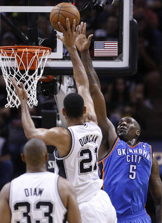 Oklahoma City's Kendrick Perkins (5) defends San Antonio's Tim Duncan (21) during Game 5 of the Western Conference Finals in the NBA playoffs between the Oklahoma City Thunder and the San Antonio Spurs at the AT&T Center in San Antonio, Thursday, May 29, 2014. Photo by Sarah Phipps, The Oklahoman