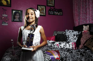 Natalie Hernandez poses for a photo at her home in Oklahoma City. PHOTO BY Sarah Phipps, The Oklahoman. SARAH PHIPPS - SARAH PHIPPS