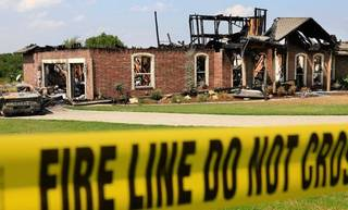On Sept, 20, 2010, authorities investigate a home invasion and arson case in Tuttle. The case remains unsolved. Photo by Jim Beckel, The Oklahoman Archives