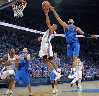 Tyson Chandler (6) of Dallas blocks a shot by Oklahoma City's Russell Westbrook (0) during game 3 of the Western Conference Finals of the NBA basketball playoffs between the Dallas Mavericks and the Oklahoma City Thunder at the OKC Arena in downtown Oklahoma City, Saturday, May 21, 2011. Photo by Chris Landsberger, The Oklahoman