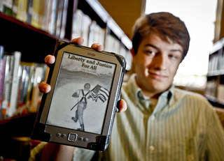 Yukon High School student Luke Swanson poses for a photo in the school's library with his self published civil war book 'Liberty and Justice For All' on Wednesday April 18, 2012, in Yukon, Oklahoma. Photo by Chris Landsberger, The Oklahoman