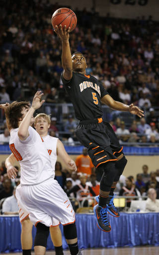 Stephen Clark scores during the 4a boys championship game where the Douglass high school Trojans play the Roland Rangers at the State Fair Arena on Saturday, March 9, 2013 in Oklahoma City, Okla. Photo by Steve Sisney, The Oklahoman