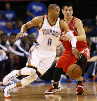 Oklahoma City's Russell Westbrook (0) drives the ball against Houston's Jeremy Lin (7) during Game 1 in the first round of the NBA playoffs between the Oklahoma City Thunder and the Houston Rockets at Chesapeake Energy Arena in Oklahoma City, Sunday, April 21, 2013. Photo by Nate Billings, The Oklahoman