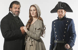 "Chuck Wagner (as Jean Valjean), Victoria Huston-Elem (Fantine) and Danny Rothman (Javert) head the cast of the Lyric Theatre production of ""Les Miserables."" Photo by K.O. Rinearson"