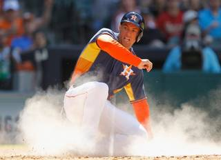 Houston Astros' George Springer slides safely into home in the seventh inning against Rojos del Aguila de Veracruz's during a spring exhibition baseball game on Sunday, March 30, 2014, in Houston. Houston won 6-1. (AP Photo/Bob Levey)