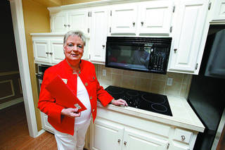 Susanne Crenshaw, a sales associate with Keller Williams Central Oklahoma in Edmond, shows the kitchen of a home she recently sold at 4417 Dahoon Drive in Oklahoma City. She is a finalist for Realtor Magazine's Good Neighbor Award. PAUL B. SOUTHERLAND - The Oklahoman