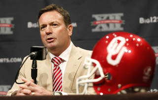 Oklahoma football coach Bob Stoops comments on his team during the Big 12 Conference Football Media Days Monday, July 23, 2013 in Dallas. (AP Photo/Tim Sharp) ORG XMIT: TXTS101