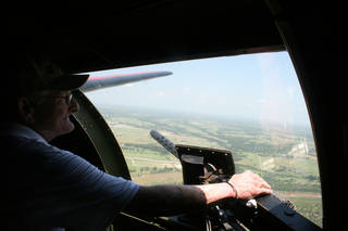 Veteran Joe Jones surveys Norman as he looks out the window of one of the .50-caliber waist machinegun positions during his ride on a World War II-era B-17 Flying Fortress bomber. Photo provided