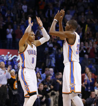 Oklahoma City's Russell Westbrook (0) and Kevin Durant (35) react during an NBA basketball game between the Oklahoma City Thunder and the Dallas Mavericks at Chesapeake Energy Arena in Oklahoma City, Thursday, Dec. 27, 2012. Oklahoma City won 111-105. Photo by Bryan Terry, The Oklahoman