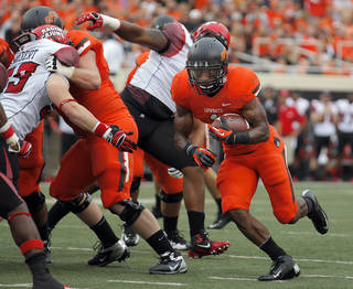 Oklahoma State's Joseph Randle (1) rushes during a college football game between Oklahoma State University (OSU) and the University of Louisiana-Lafayette (ULL) at Boone Pickens Stadium in Stillwater, Okla., Saturday, Sept. 15, 2012. Photo by Sarah Phipps, The Oklahoman