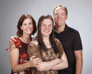 HIGH SCHOOL SWIMMING / DAWN HILDEBRAND: All-City Swimmer Jessi Hildebrand with her parents, Dawn and Devin Hildebrand at OPUBCO studio Tuesday April 3, 2012. Photo by Doug Hoke, The Oklahoman