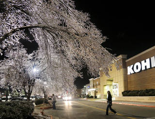 Ice on the trees in the parking lot glistens as shoppers leave stores atTown Center Plaza Retail Mall in Midwest City on Sunday night, Dec. 22, 2013. Photo by Jim Beckel, The Oklahoman