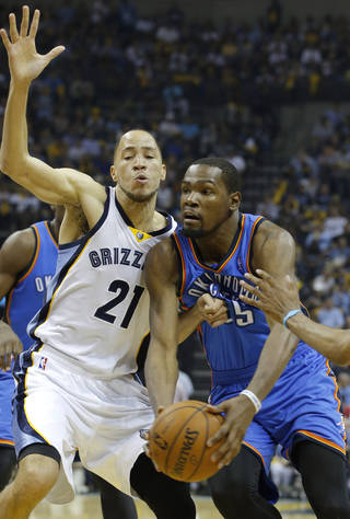 Oklahoma City's Kevin Durant (35) tries to get past Memphis' Tayshaun Prince (21) during Game 3 in the first round of the NBA playoffs between the Oklahoma City Thunder and the Memphis Grizzlies at FedExForum in Memphis, Tenn., Thursday, April 24, 2014. Photo by Bryan Terry, The Oklahoman