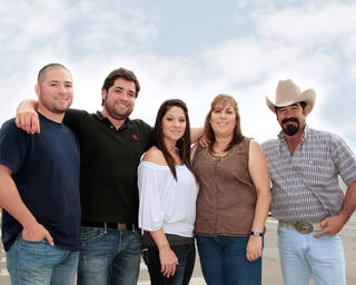 Frankie and Connie Marquez were among the first Mexican-Americans to start a family in Hennessey. From left: Eric, Randy, Betsy, Connie and Frankie. (Photo by Warren Vieth, Oklahoma Watch) Warren Vieth