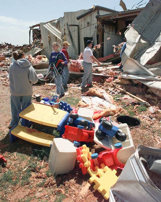 In this May 1999 photograph, members of Ridgecrest Baptist Church in Bridge Creek remove toys and furniture from the church's day-care center that was destroyed by a tornado about 45 minutes after the children left. DAVID MCDANIEL