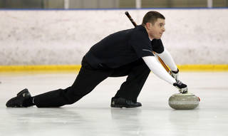 Ryan McGhee delivers a stone while curling with the Oklahoma Curling Club at the Arctic Edge Ice Arena in Edmond, Okla., Sunday, Jan. 26, 2014. Photo by Nate Billings, The Oklahoman