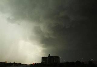 A severe storm passes over east Tulsa and the Renaissance Hotel, in Tulsa, Okla., on Thursday, April 14, 2011. (AP Photo/Tulsa World, James Gibbard)
