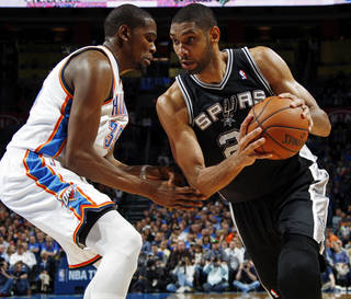 San Antonio's Tim Duncan (21) works against Oklahoma City's Kevin Durant (35) during an NBA basketball game between the Oklahoma City Thunder and the San Antonio Spurs at Chesapeake Energy Arena in Oklahoma City, Thursday, April 4, 2013. Photo by Nate Billings, The Oklahoman
