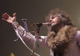 NEW YEAR'S EVE CELEBRATION / COCA-COLA BRICKTOWN EVENTS CENTER / FLAMING LIPS CONCERT: Wayne Coyne, of the Flaming Lips, performs during the Flaming Lips New's Year's Freak Out at the Coca Cola Event Center in Oklahoma City, Saturday, Dec. 31, 2011. Photo by Garett Fisbeck, The Oklahoman ORG XMIT: KOD