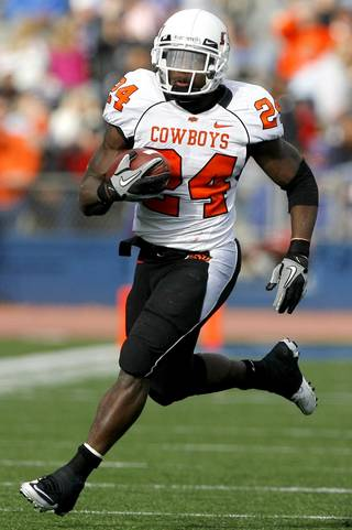 Oklahoma State's Kendall Hunter (24) runs up field during the college football game between Oklahoma State (OSU) and Kansas (KU), Saturday, Nov. 20, 2010 at Memorial Stadium in Lawrence, Kan. Photo by Sarah Phipps, The Oklahoman
