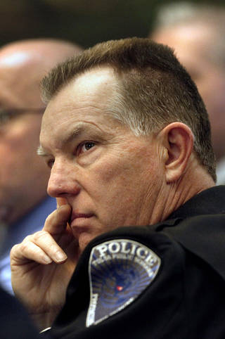 Tulsa Public Schools Campus Police Chief Gary Rudick listens with other committee members to a presentation Tuesday at a meeting of the Oklahoma Commission on School Security at the state Capitol. Photo by Jim Beckel, The Oklahoman