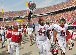 Oklahoma's Franks Alexander (84) and Travis Lewis (12) walk off the field at half time during the Red River Rivalry college football game between the University of Oklahoma Sooners (OU) and the University of Texas Longhorns (UT) at the Cotton Bowl in Dallas, Saturday, Oct. 8, 2011. Photo by Chris Landsberger, The Oklahoman