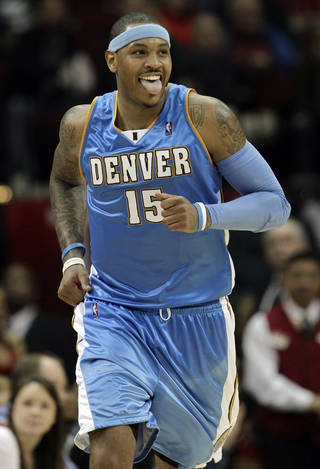 The New Jersey Nets are working to acquire Carmelo Anthony, sources told the Associated Press. AP PHOTO