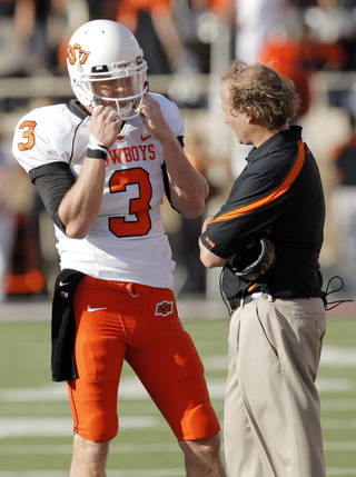 OSU quarterback Brandon Weeden (3) talks to offensive coordinator Dana Holgorsen during the college football game between the Oklahoma State University Cowboys and Texas Tech University Red Raiders at Jones AT&T Stadium in Lubbock, Texas, Saturday, October 16, 2010. OSU won, 34-17. Photo by Nate Billings, The Oklahoman ORG XMIT: KOD