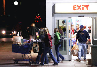 Customers leave Toys R Us on Friday after bargain shopping early in Tulsa. PHOTO BY JAMES GIBBARD, TULSA WORLD