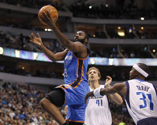 Oklahoma City Thunder guard James Harden (13) drives in front of Dallas Mavericks forward Dirk Nowitzki (41), of Germany, and guard Jason Terry (31) during the first half of an NBA basketball game Monday, Jan. 2, 2012, in Dallas. (AP Photo/Tim Sharp) ORG XMIT: DNA101