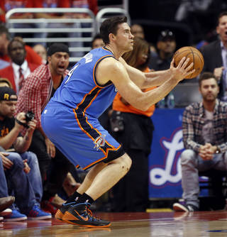 Oklahoma City's Nick Collison (4) takes and makes a 3-point shot in the second half during Game 6 of the Western Conference semifinals in the NBA playoffs between the Oklahoma City Thunder and the Los Angeles Clippers at the Staples Center in Los Angeles, Thursday, May 15, 2014. Photo by Nate Billings, The Oklahoman