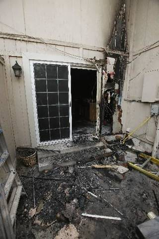 Fire damage at the rear of a condominium unit in the 9700 block of Hefner Village Blvd., on the west side of Lake Hefner, in Oklahoma City Wednesday, Sept. 26, 2012. Photo by Paul B. Southerland