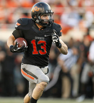 Oklahoma State's David Glidden (13) runs after a catch during a college football game between the Oklahoma State University Cowboys (OSU) and the University of Kansas Jayhawks (KU) at Boone Pickens Stadium in Stillwater, Okla., Saturday, Nov. 9, 2013. Photo by Nate Billings, The Oklahoman