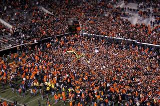 Oklahoma State fans celebrate following the Bedlam college football game between the Oklahoma State University Cowboys (OSU) and the University of Oklahoma Sooners (OU) at Boone Pickens Stadium in Stillwater, Okla., Saturday, Dec. 3, 2011. Photo by Bryan Terry, The Oklahoman BRYAN TERRY